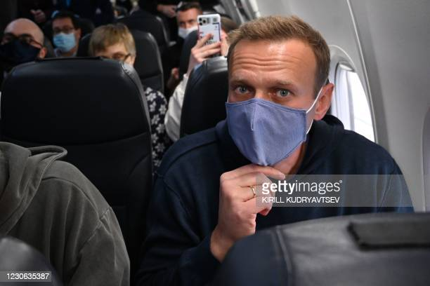 Russian opposition leader Alexei Navalny sits in a Pobeda airlines plane heading to Moscow before take-off from Berlin Brandenburg Airport in...