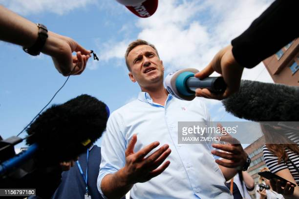 Russian opposition leader Alexei Navalny speaks with journalists during a rally to support opposition and independent candidates after authorities...