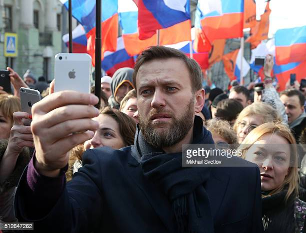 Russian opposition leader Alexei Navalny takes a selfie photo during a mass march marking the oneyear anniversary of the killing of opposition leader...