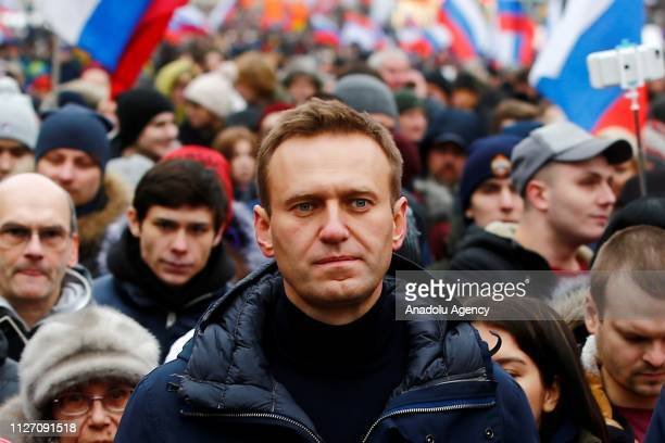 Russian opposition leader Alexei Navalny takes part in a march at Strastnoy Boulevard in memory of Russian politician and opposition leader Boris...