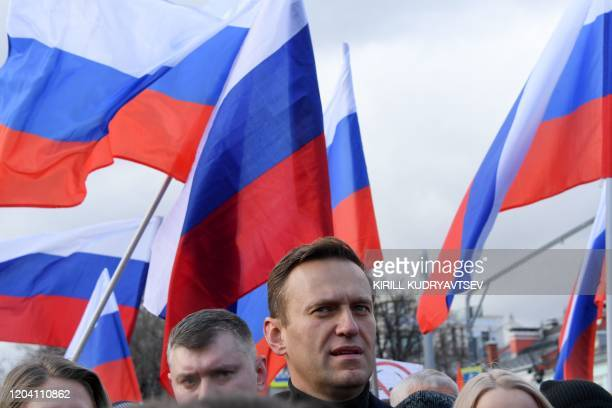 Russian opposition leader Alexei Navalny takes part in a march in memory of murdered Kremlin critic Boris Nemtsov in downtown Moscow on February 29,...