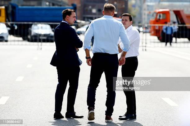 Russian opposition leader Alexei Navalny talks with Candidate Ivan Zhdanov and Russian opposition activist Ilya Yashin during a rally in support of...