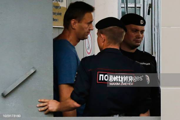 TOPSHOT Russian opposition leader Alexei Navalny walks outside the Danilovsky police station in Moscow after being detained on August 25 2018 Navalny...