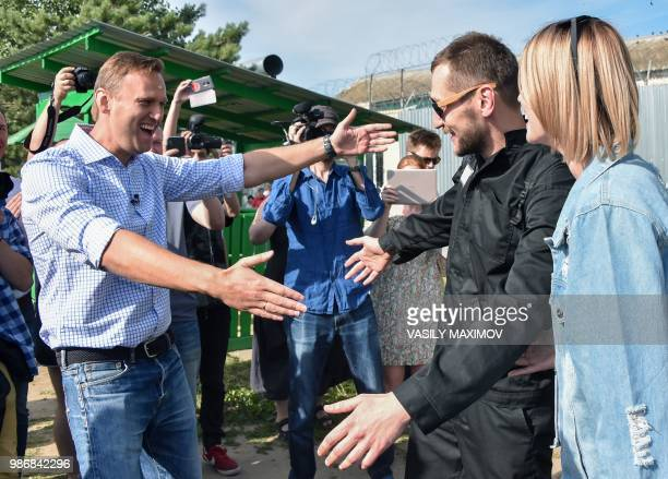 Russian opposition leader Alexei Navalny welcomes his younger brother Oleg in the village of Naryshkino in the Oryol region south of Moscow on June...