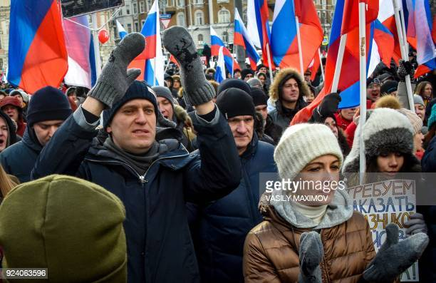 Russian opposition leader Alexey Navalny and his wife Yulia attend an opposition march in memory of murdered Kremlin critic Boris Nemtsov in central...