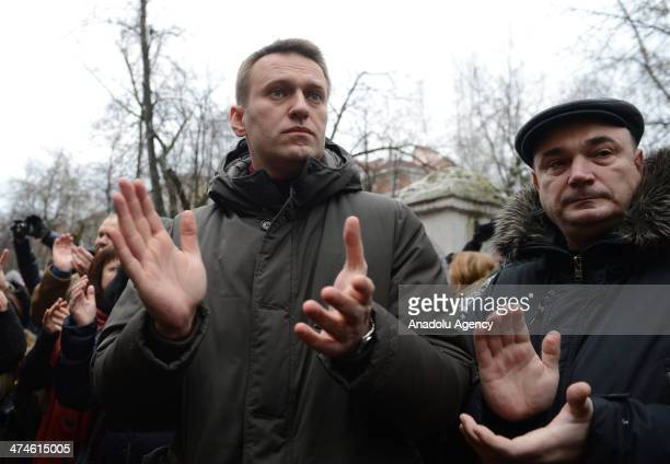 Russian opposition leader and lawyer Alexei Navalny applauds during the ''Bolotnaya trial'' in Moscow on February 24 2014 The trial about the protest...