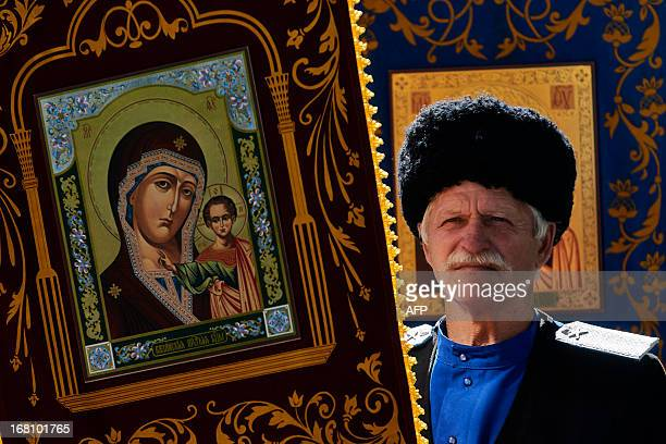 A Russian Orthodox believer holds an icon as he celebrates Easter in the city of Stavropol on May 5 2013 AFP PHOTO/DANIL SEMYONOV