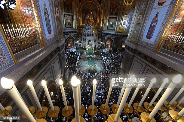 Russian Orthodox believers attend a Christmas service in Christ the Savior cathedral in Moscow early on January 7 2017 Orthodox Christians celebrate...