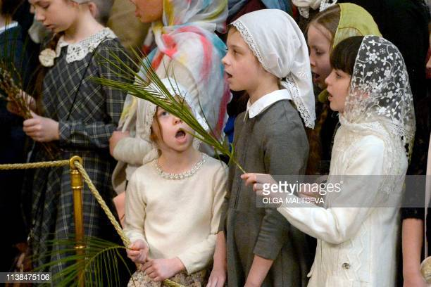 Russian Orthodox believers attend a Palm Sunday service at Saint Petersburg's Saint Isaac's Cathedral on April 21 2019