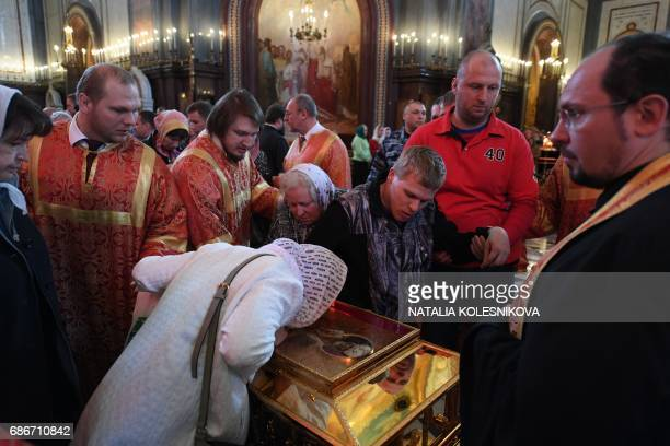 Russian Orthodox believers kiss the relics of Saint Nicholas in the Christ the Savior Cathedral in Moscow on May 22 2017 The relics of one of the...