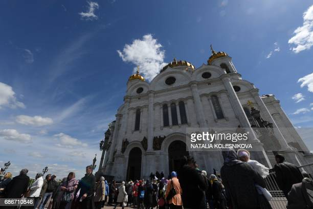 Russian Orthodox believers leave the Christ the Savior Cathedral after kissing the relics of Saint Nicholas in Moscow on May 22 2017 The relics of...
