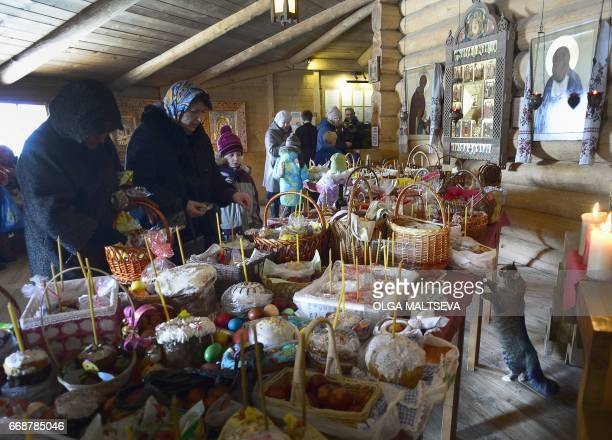 A Russian Orthodox believers prepare the Orthodox Easter celebration in Pokrovsky Cathedral in Saint Petersburg on April 15 on the eve of the...