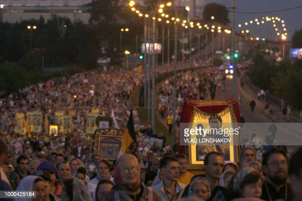 TOPSHOT Russian Orthodox believers take part in a nightime procession marking 100 years since the Bolsheviks shot dead tsar Nicholas II and his...