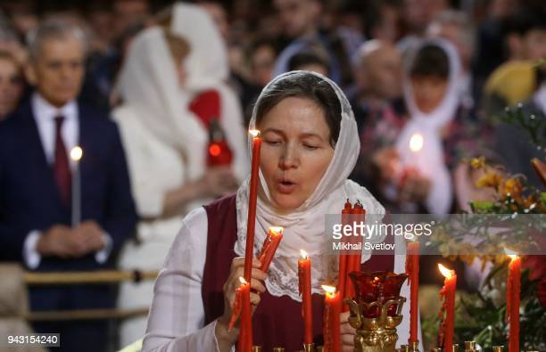Russian Orthodox belivers light candles during the Orthodox Easter service in the Christ the Saviour Cathedral in Central Moscow Russiaearly April...