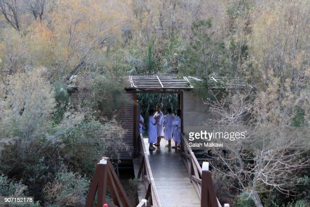 Russian Orthodox Christian pilgrims prepare to get get baptized in the waters of the eastern bank of the Jordan River on January 19 2018 in Tal...
