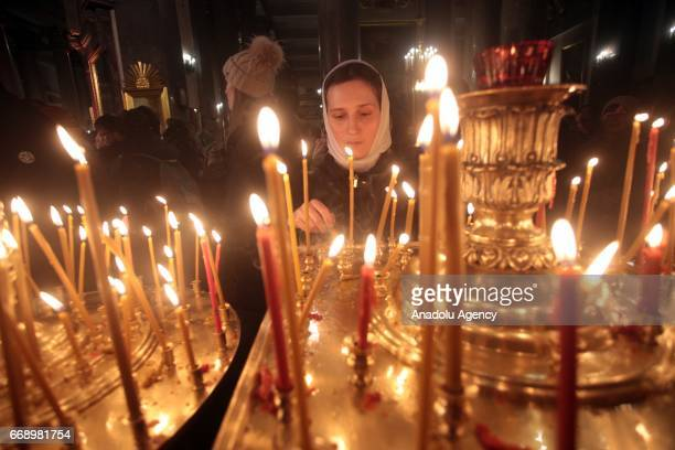 Russian Orthodox Christians attend an Orthodox Easter service in the Kazan Cathedral on April 16 2016 in SaintPetersburg Russia Easter is a festival...
