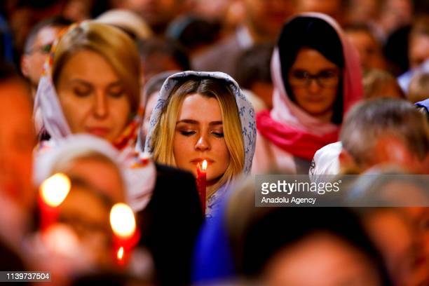 Russian Orthodox Christians attend the Easter service at the Cathedral of Christ the Saviour in Moscow, Russia on April 27, 2019. The Russian...