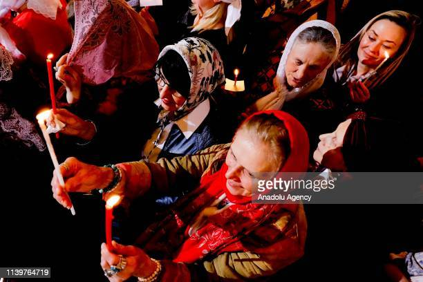 Russian Orthodox Christians attend the Easter service at the Cathedral of Christ the Saviour in Moscow Russia on April 27 2019 The Russian Orthodox...