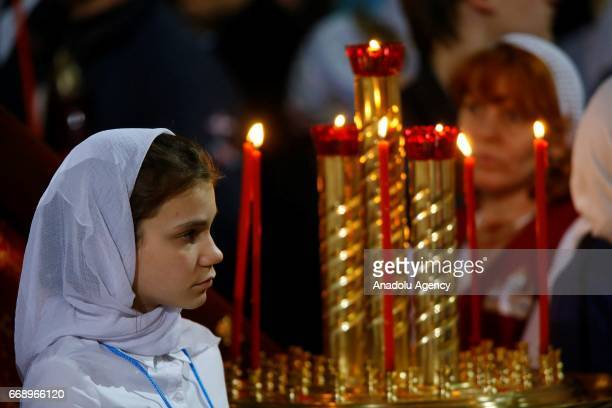 Russian Orthodox Christians attend the Easter service led by Patriarch Kirill of Russia in Christ the Savior Cathedral in Moscow Russia on April 15...