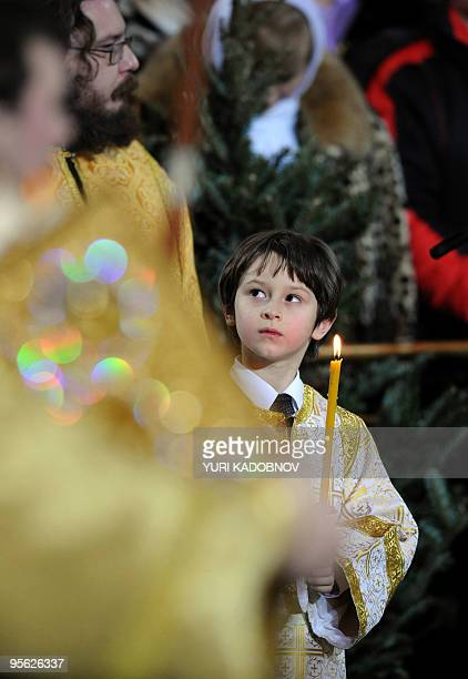 Russian Orthodox church boy attends the Orthodox Christmas service in Moscow's Christ The Savior Cathedral late on January 6 2010 Most Russians mark...