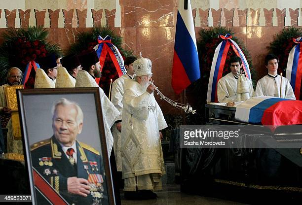 Russian Orthodox Church Metropolitan Juvenaly of Krutitsy and Kolomna blesses the coffin during the funeral ceremony for Mikhail Kalashnikov at the...