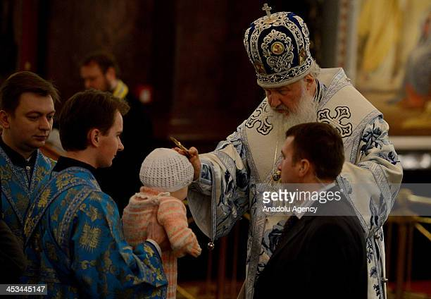 Russian Orthodox Church Patriarch Kirill and many other Russian citizens gather at Russian Orthodox Church on December 3 2013 in Moscow Russia for a...