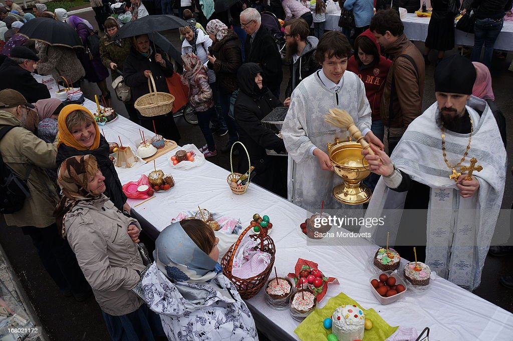 A Russian Orthodox Church priest blesses painted eggs and cakes during celebration of the Orthodox Easter in the Trinity Church May,4, 2013 in Moscow, Russia. Thousands of Russian Orthodox Church belivers attend the Easter celebrations in Moscow.