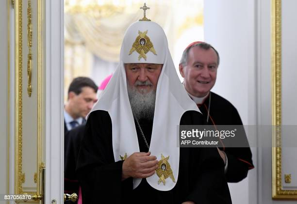 Russian Orthodox Patriarch Kirill and Vatican Secretary of State Cardinal Pietro Parolin leave a hall during a meeting in Moscow on August 22 2017 /...