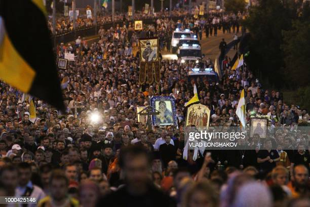 Russian Orthodox Patriarch Kirill leads believers in a nightime procession marking 100 years since the Bolsheviks shot dead Tsar Nicholas II and his...