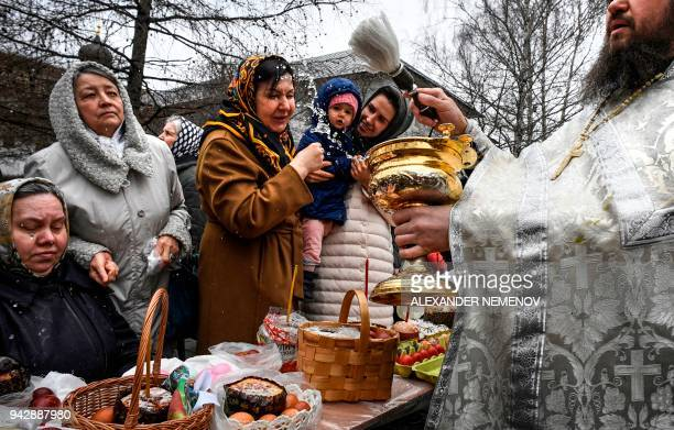 A Russian Orthodox priest blesses cakes and colored eggs during an Orthodox Easter ceremony in Moscow on April 7 on the eve of the Orthodox Easter /...
