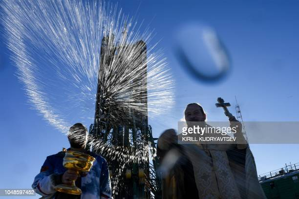 Russian Orthodox priest blesses the Soyuz MS10 spacecraft at the launch pad of the Russianleased Baikonur cosmodrome on October 10 2018 The launch of...