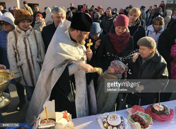 Russian Orthodox priest Father Dimitry blesses traditional Easter eggs and cakes in preparation of Orthodox Easter in the Tritity Church April 7 2018...