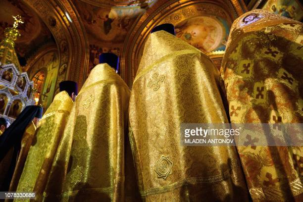 TOPSHOT Russian Orthodox priests celebrate a Christmas service at Christ the Savior cathedral in Moscow late on January 6 2019 Orthodox Christians...