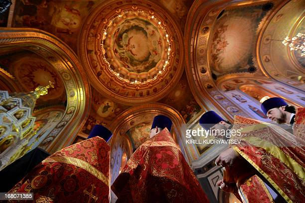 Russian Orthodox priests celebrate Easter at the Christ the Savior Cathedral in Moscow early on May 5 2013 AFP PHOTO/KIRILL KUDRYAVTSEV