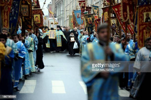 Russian orthodox priests hold icons as activists of various Russian nationalist movements take part in a rally during the National Unity Day in Saint...