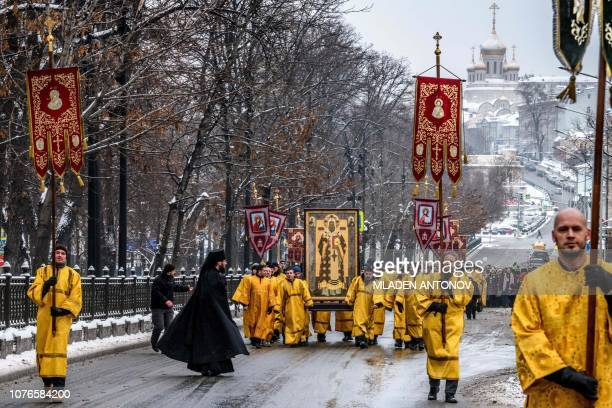 Russian Orthodox priests walk during a religious procession celebrating Saint Peter of Kiev Metropolitan of Kiev and Moscow at the Vissoko Petrovsky...