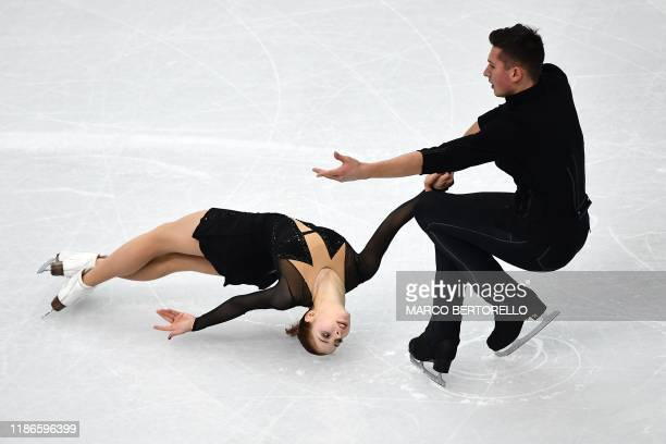 Russian pair Anastasia Mishina and Aleksandr Galliamov compete during the Pairs short program at the ISU Grand Prix of figure skating Final 2019 on...
