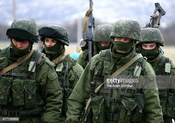 Russian paramilitaries stand guard outside of a Ukrainian military base on March 6 2014 in Simferopol Ukraine As the standoff between the Russian...