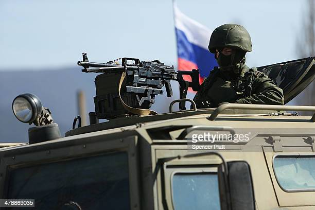 Russian paramilitaries stand guard outside of a Ukrainian military base in the town of Perevevalne near the Crimean city of Simferopol on March 11...