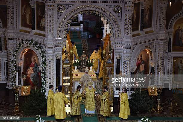 Russian Patriarch Kirill celebrates a Christmas service in Christ the Savior cathedral in Moscow early on January 7 2017 Orthodox Christians...