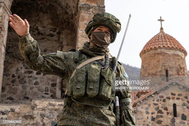Russian peacekeeper gestures in the yard of the 12th-13th century Orthodox Dadivank Monastery on November 16 after the monastery was put under...