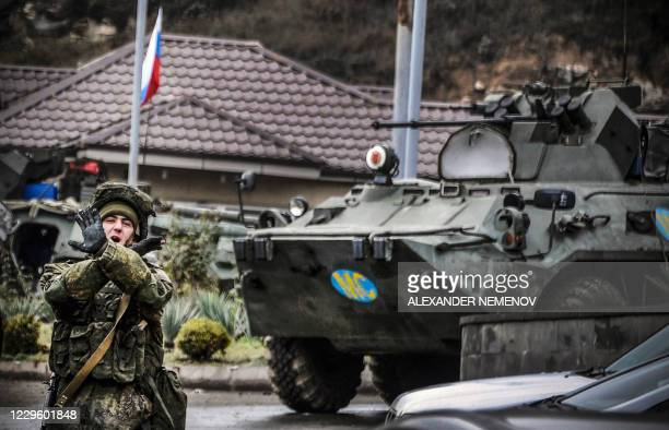 Russian peacekeeper shouts No pictures at a checkpoint outside the city of Stepanakert on November 13 during a ceasefire in the military conflict...