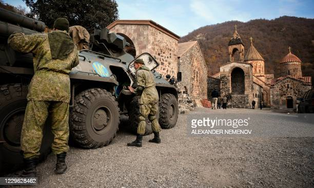 Russian peacekeepers check their equipment in their Armoured Personnel carrier stationed in front of the 12th-13th century Orthodox Dadivank...