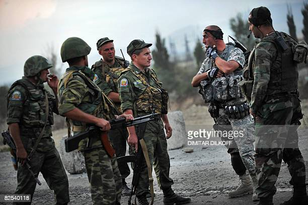 Russian peacekeepers talk with Georgian soldiers at the last checkpoint on the GoriTbilisi road on August 22 near the village of Khurvaleti Hundreds...