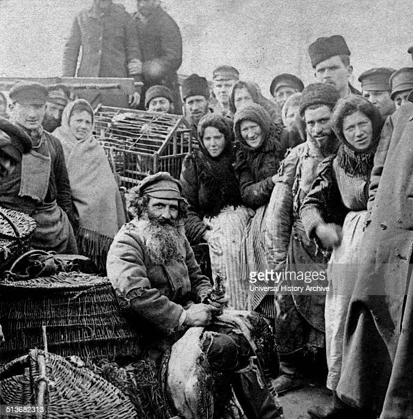 Russian peasants gather at a market in Moscow 1900 Living under harsh conditions in Russia the life of a Russian peasant tended to be hard and they...