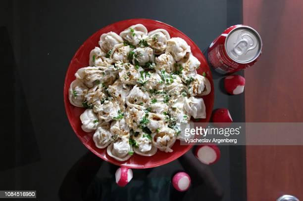russian pelmeni (dumplings) - argenberg stock pictures, royalty-free photos & images