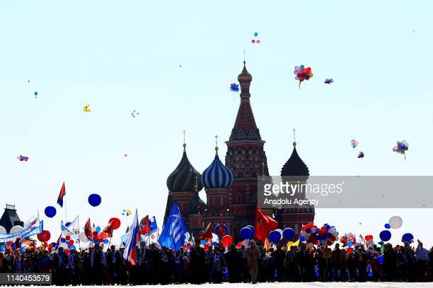 Russian people with balloons and flags take part in a rally to mark May Day International Workers' Day at Red Square in Moscow Russia on May 1 2019