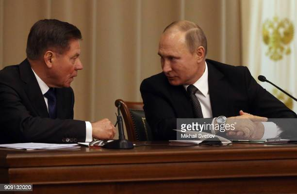 Russian Persident Vladimir Putin talks to Supreme Court 's Charman Vyacheslav Lebedev during a meeting of the Supreme Court marking its 95th...