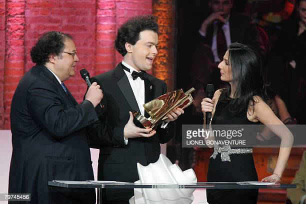 Russian pianist Evgueny Kissin receives a honnor award from TV host Marie Drucker during the 15th Victoires de la Musique classique awards ceremony...