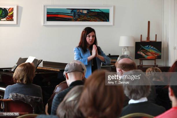 Russian pianist GeNIA gives a piano yoga workshop near a Steinway grand piano in the Salon during 'It's All About Piano!' festival at The Institut...